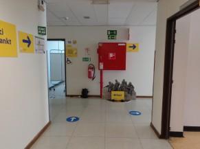 Fin du circuit (salle d'attente après vaccination)